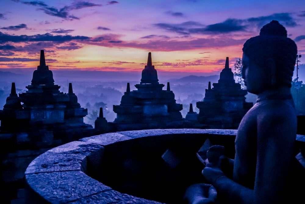 Buddha and sunrise Yogyakarta temple