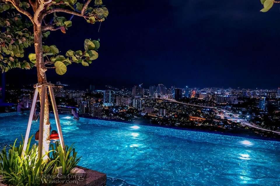 Kuala Lumpur at night from an infinity pool.